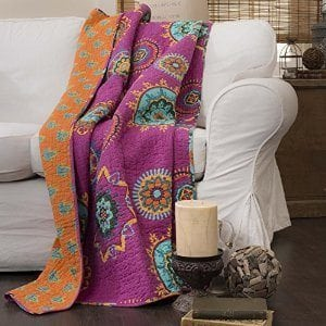Colorful ethnic or boho prints on throws and pillows are a fun way to add a little pizzazz.