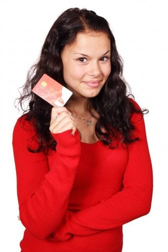 credit card guide - girl holding a credit card