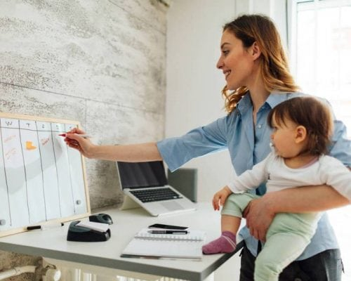 work from home mom writing on whiteboard
