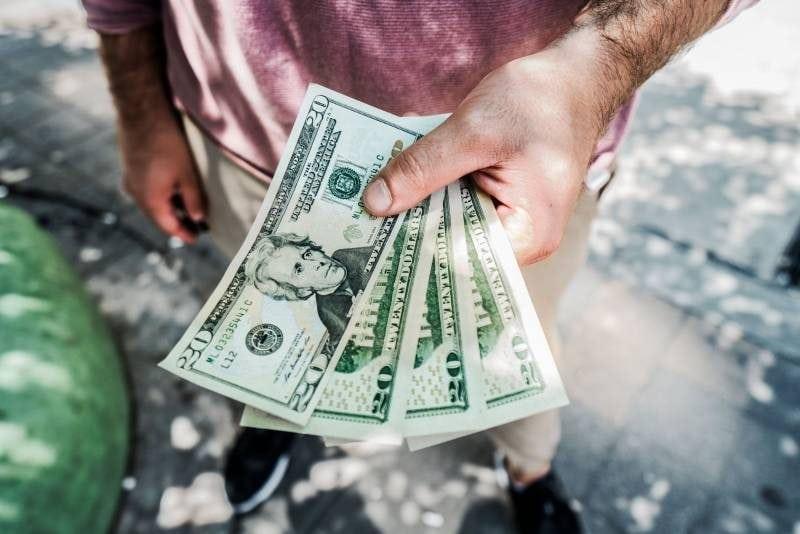 cash handing out man