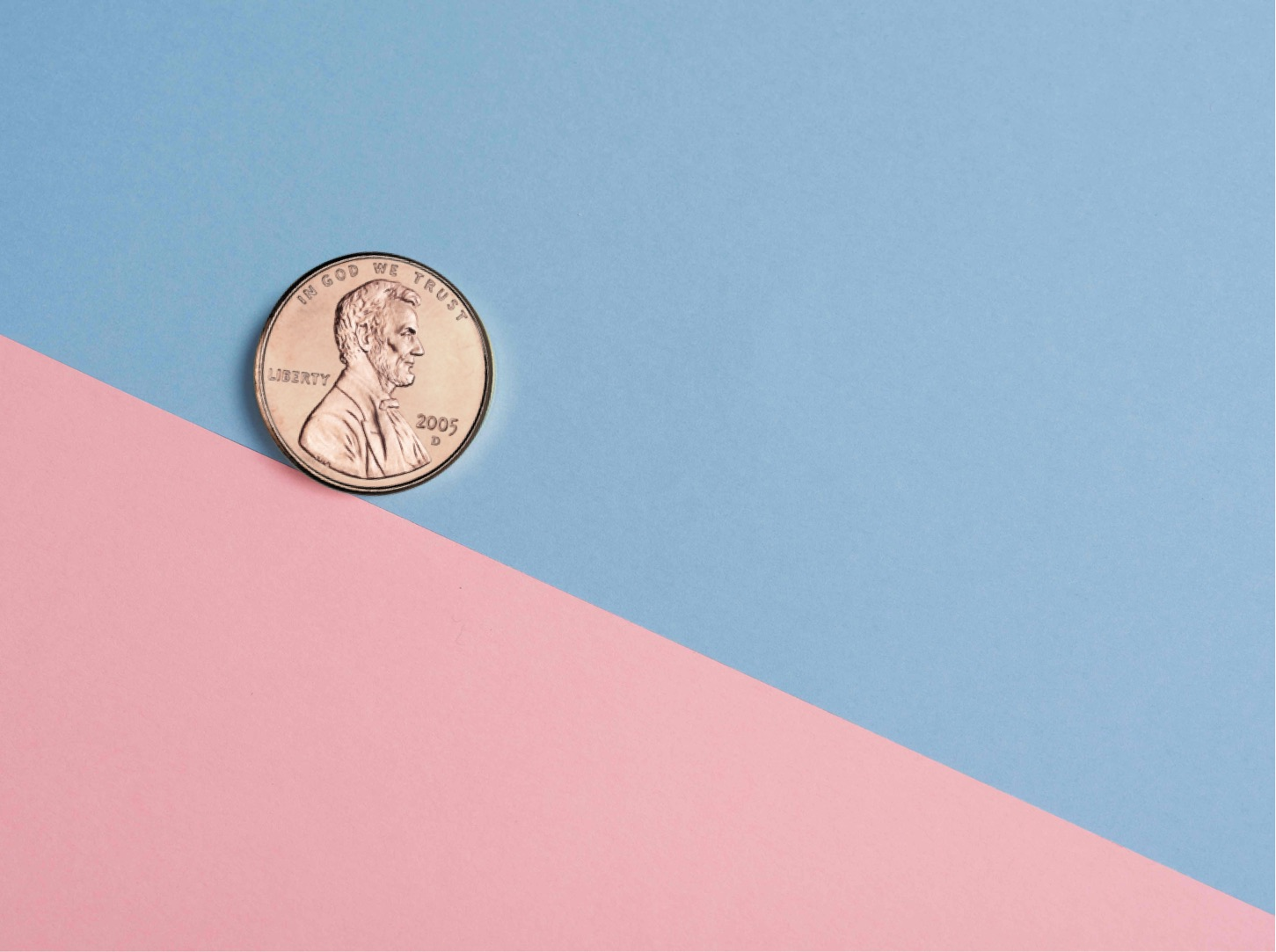 a penny on a pink and blue surface