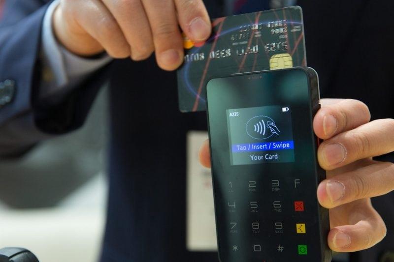 A man processing a credit card