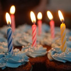 Cupcakes with lit birthday candles