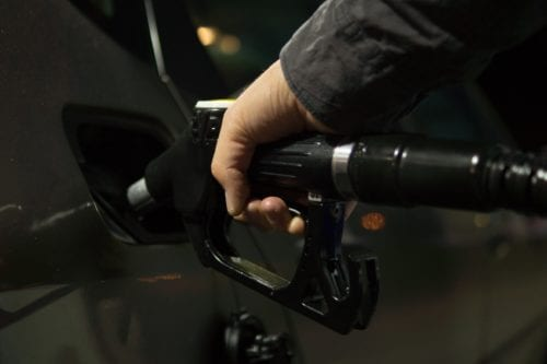 Image of a hand holding a gas pump