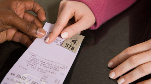 two hands pointing to a receipt