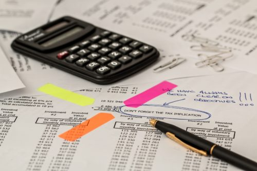 A calculator and a page of financial calculations